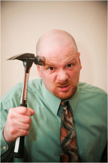project manager with a hammer, loosing his mind