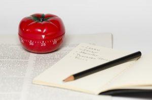 tomato ktchen timer, notebook, pencil, article